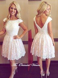 ed1c77372 blanco 2016 Sexy encaje trasero Una línea de vestidos largos de graduación  hasta la rodilla longitud