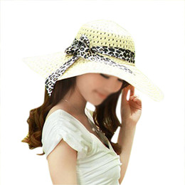 d52c9c8c2db89 Wholesale- NEW STYLE Beige Summer Exquisite Leopard Ribbon Bowknot  Decorated Openwork Sun Hat For Women