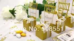 chairs charm Australia - Wholesale- Free Shipping Paper Wedding Gold Miniature Chair Candy Favor Box Wedding Gift Box With Heart Charm And Ribbon 12pcs