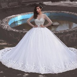 Tulle Jewel Neckline Wedding Dress Canada - Stunning 2016 Crystals Wedding Dress Ball Gown Sheer Jewel Neckline Long Sleeves Beaded Top Tulle Bridal Gowns Lace Appliques Hem