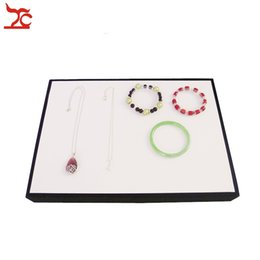 Necklace Display Cases Canada - Classic Jewelry Display Prop White and Black leather Pu Bracelet Bangle Necklace Holder Case Flat Jewelry Organizer Display Tray
