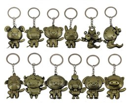 $enCountryForm.capitalKeyWord NZ - New arrival Retro zodiac keychain cartoon metal key ring animal model key pendant R035 Arts and Crafts mix order