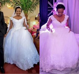 2016 African Arabic Ball Gown Wedding Dresses V Neck Cap Sleeves Lace  Appliques Beaded Bling Tulle Puffy Court Train Plus Size Bridal Gowns 4f6d91ec79ff