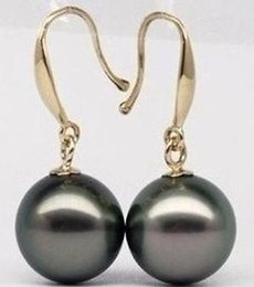 Peacock Studs UK - Elegant 10-11mm natural tahitian peacock green pearl earrings 14k gold