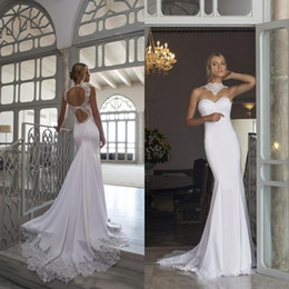 China Sexy 2019 Riki Dalal Wedding Dresses Mermaid Open Back High Neck Illusion Lace Appliques Fit and Flare Beach Bridal Gowns Custom Made suppliers