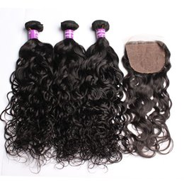Malaysian Wavy Human Hair Canada - Malaysian Human Hair 4pcs Lot Water Wave Silk Base Closure With Bundles Unprocessed Hair Extension Wet and Wavy With Silk Top Lace Closure