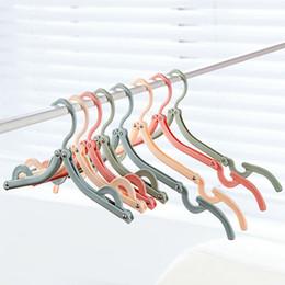 Magic Dresses Wholesale Canada - The portable travel folding clothes rack Outdoor travel multi-function magic clotheshorse Plastic non-slip hanger 31 g
