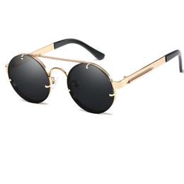 dfbe2b3636 Vintage redondo Steampunk gafas de sol mujeres hombres moda retro círculo  metal Steam Punk gafas de sol hombres oro negro gafas UV400 L67