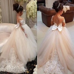 China Beautiful Sheer Appliqued Long Sleeves Flower Girl Dresses Sheer Jewel Neck Princess Girls Formal Pageant Gowns With Big Bow Sash supplier gold dresses big bows suppliers