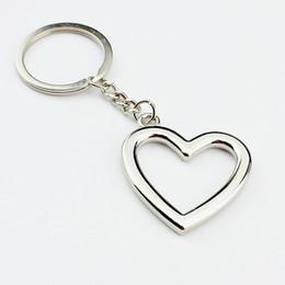 Vente en gros 100pcs / lot nouvelle nouveauté chaude en alliage de zinc en forme de coeur porte-clés porte-clés en métal pour les amoureux livraison gratuite