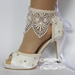 Wedding goWns shoes online shopping - 2017 White Peep Toe Lace Wedding Shoes With Adjustable Ribbon Luxury Pearls Rhinestone CM High Heel Women Pumps Bridal Party Gown