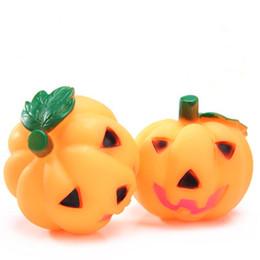 100pcs lot fashion pet dog toys squeak pumpkin for halloween dog cat chew toy plastic for small medium large pets discount small plastic pumpkins - Large Plastic Pumpkins