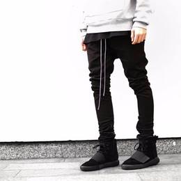 178e7bb61 Streetwear Harem Pants Men Draw String Elastic Waist Hip Hop Pants Leg  Opening Zipper Male Trousers kanye justin bieber pants