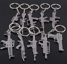 $enCountryForm.capitalKeyWord UK - FREE shipping by FEDEX 100pcs lot 2014 Wholesale Zinc Alloy Cross Fire Gun Keyring Metal Imitation Gun Pendant Keychain