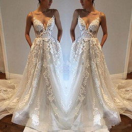 China Spaghetti Straps Wedding Dress with Pockets Sheer Deep V Neck Sexy New A Line Bridal Gowns Lace Appliques Backless Custom Size Princess suppliers