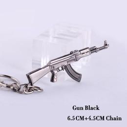 $enCountryForm.capitalKeyWord Canada - Novelty Items Counter Strike AK47 Guns Keychain Trinket Awp Rifle Sniper Key Chain Key Ring Jewelry Souvenirs Gift Men Llaveros