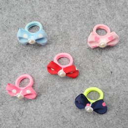 Dog Bands Canada - Pet accessories head wave flower butterfly knot hair wrapped around the sun flower Teddy hair band Dog aaccessories 50pcs lot