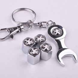 $enCountryForm.capitalKeyWord Canada - New Hot Sale Car Wheel Tire Valve Caps with Mini Wrench & Keychain for Peugeot (4-Piece Pack)