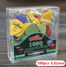 $enCountryForm.capitalKeyWord Canada - 100pcs High Quality Thin 0.81mm Acoustic Electric Guitar Picks parts Plectrums + 1 Plastic Picks Box Case musical instruments