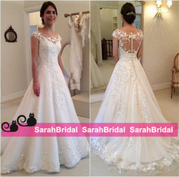 See Through Wedding Dress Crystal Beading Canada - 2016 Modest Design New Lace Appliques Wedding Dresses A line Sheer Bateau Neckline See Through Button Back Bridal Gown Cap Sleeves Vestidos
