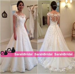 80756910fd4 2016 Modest Design New Lace Appliques Wedding Dresses A line Sheer Bateau  Neckline See Through Button Back Bridal Gown Cap Sleeves Vestidos