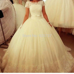 short ball gowns wedding dresses Canada - Vestidos De Novias Lace Tulle Modest Wedding Dresses with Short Cap Sleeves Ball Gown Puffy Bridal Gowns Sheer Illusion Neckline Plus Size