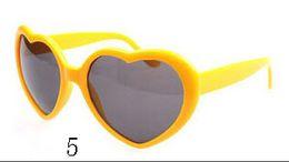 $enCountryForm.capitalKeyWord Canada - 10pcs Cheap Modern Heart Shaped Women Sunglasses Oculos Polarizado Plastic Classic Sunglasses Influx Of People Love Woman Glasses With Bag