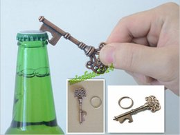 can bottle Australia - Hot Novelty Mini UK Suck KeyChain Key Chain Beer BottleOPENER Stainless Bottle Opener Coca Can Opening tool wth Ring KPQ01