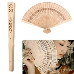 $enCountryForm.capitalKeyWord Canada - Retro Hollow Folding Wooden Hollow Carved Foldable Hand Fan Gifts Brand New Good Quality Free Shipping
