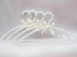 $enCountryForm.capitalKeyWord Canada - Free shipping 100pcs lot plastic pearl hanger adult clothes hanger hanging racks anti-slip laundry rack drying hanger