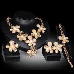 $enCountryForm.capitalKeyWord Australia - Earrings Necklaces Bracelets Rings Jewelry Sets Luxury Quality Pearl & Rhinestone 18K Gold Plated Flowers Wedding Jewelry 4-piece Set JS044