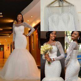 Bridal Satin Mermaid Wedding Dresses Canada - 2018 New African Nigeria Sheath Mermaid Wedding Dresses Jewel Neck Long Sleeves Crystal Beaded Pearls Sweep Train Custom Formal Bridal Gowns