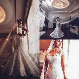 Bridal Satin Mermaid Wedding Dresses Canada - 2017 Elegant Mermaid Wedding Dresses Vintage Jewel Neck Sheer Long Sleeves Lace Appliques Beads Beach Button Back Custom Formal Bridal Gowns