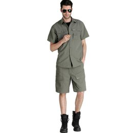 73a2fd8f28b0 Wholesale-2016 New Lightweight Outdoor Sport Men Summer Style Set  Multi-pockets Quick Dry Fish Shirts Leg Pants Casual Travel Suit