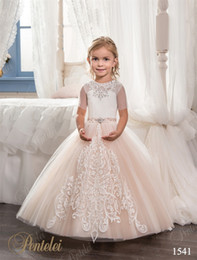 Custom Short Gown Canada - Ivory Flower Girls Dresses with Short Sleeves 2017 Pentelei Beaded Crystals Appliques Tulle Litte Girls Birthday Gowns Custom Made