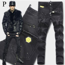 Chinese  Euro Fashion Men Black Stretch Jeans Tidy Biker Denim Jean Paint Spot Damage Slim Fit Distressed Cowboy Pants Man Yellow Metal Patch manufacturers