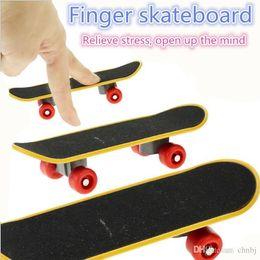 $enCountryForm.capitalKeyWord Canada - Finger board toys flip Skate Board cute party like children education decompression toys gifts Fskate Boarding FEB