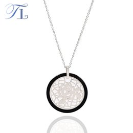 $enCountryForm.capitalKeyWord NZ - TL Black & White Ceramic Round Pendant Necklace For Women Stainless Steel Hollow Rose Sheet Ceramic Jewelry With Extended Chain