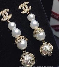 Venta al por mayor de Perla perforada personalizada de alta calidad Zircon Earrining