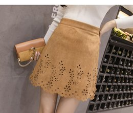 3ce0943ce15 New women s autumn fashion high waist suede leather a-line cute sexy hollow  out floral short skirt SMLXLXXL