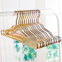 coat hanger designs Canada - Metal Hangers Adult Suit Thickening Shelf Clothes Drying Racks Anti Skidding Curve Design Coat Hanger Seamless Rose Gold Rack