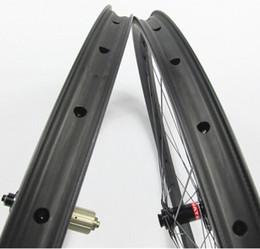 China 29erx27mm width carbon wheelset hookless 23mm depth front M15 thru rear 142mm X12 SUPER LIGHT MTB XC 650B carbon tubeless wheels suppliers