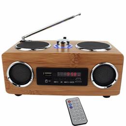 Vente en gros Haut-parleur portable multifonction fait main en bambou Mini salut-fi Haut-parleur en bambou en bois avec lecteur de carte TF / USB Radio FM avec télécommande Lecteur MP3