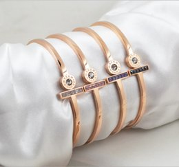 Chinese  New fashion plated titanium steel rotating bracelet Roman numeral black rose gold contracted steel color nonallergic accessories manufacturers