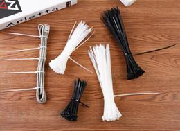 Attaches autobloquantes en câble blanc noir autobloquant en nylon blanc en Solde