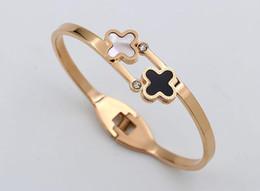 Chinese  New black and white bicolor double diamond shell bracelet Korean version of titanium wide fashion ladies diamond accessory bracelet manufacturers