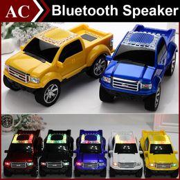 Car Mp3 Player Speaker Canada - Truck Car Shape Model Mini Wireless Bluetooth Speaker Portable Subwoofer LED Flash Light USB TF Card Stereo FM Radio MP3 Music Player