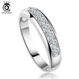 49ef1d8a67dc ORSA JEWELS Banda de boda de circonio austríaco de lujo para mujeres anillo  de eternidad venta al por mayor Rose GoldSliver Color Ring Supplier OR24