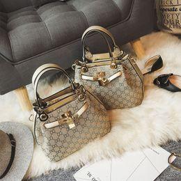 65c3116aafc9 Ladies Handbags Tote bag Shoulder bag Fashion European print Lock Canvas PU  leather With big capacity New bag 2017 New arrival