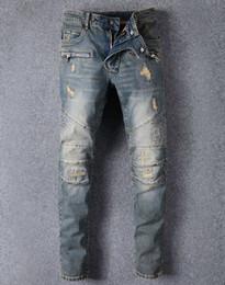 Men s juMpsuits online shopping - Famous Brand Designer Men Jeans Ripped Jeans Blue Rock Star Mens Jumpsuit Designer Denim Male Pants